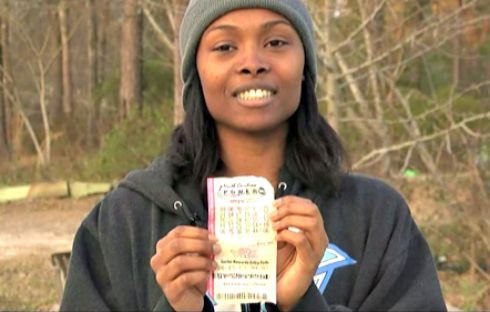 Marie Holmes and her winning lottery ticket